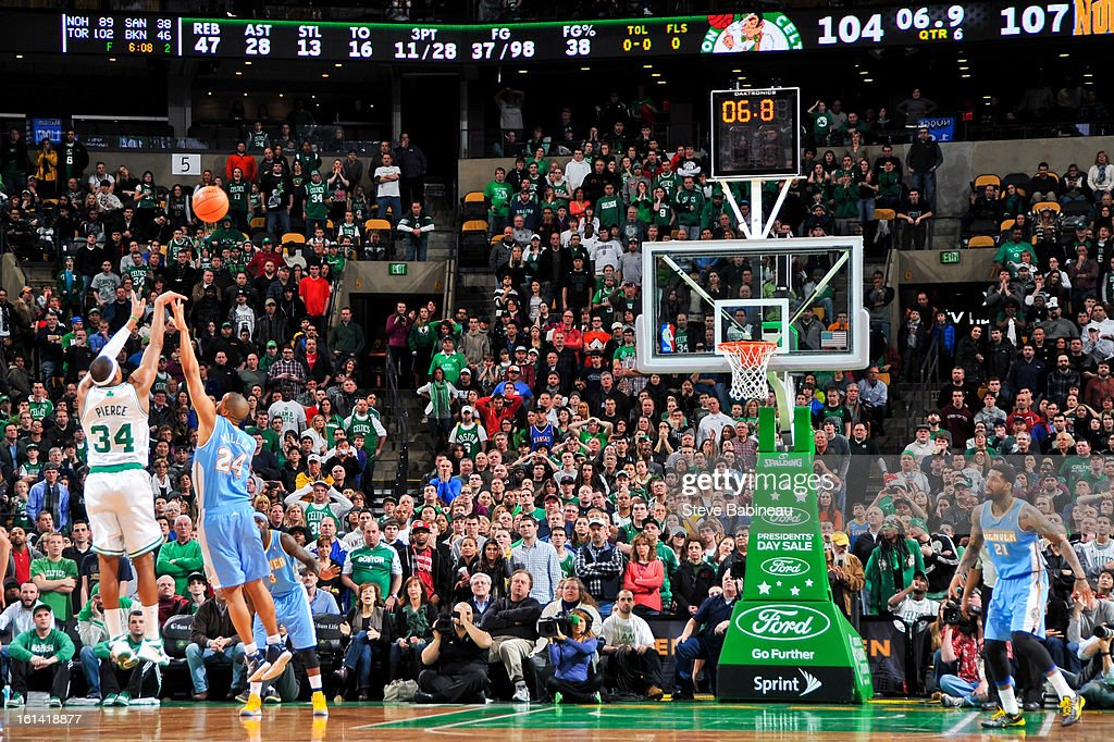 Paul Pierce #34 of the Boston Celtics makes a three-pointer to tie the game against Andre Miller #24 of the Denver Nuggets in double overtime on February 10, 2013 at the TD Garden in Boston, Massachusetts.