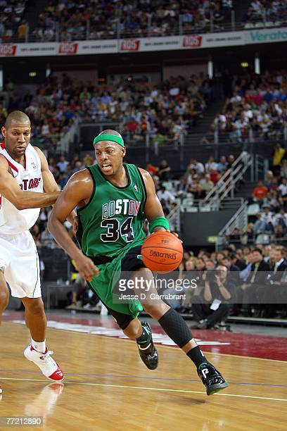 Paul Pierce of the Boston Celtics moves the ball past Joey Graham of the Toronto Raptors during the NBA Preseason game as part of the 2007 NBA Europe...
