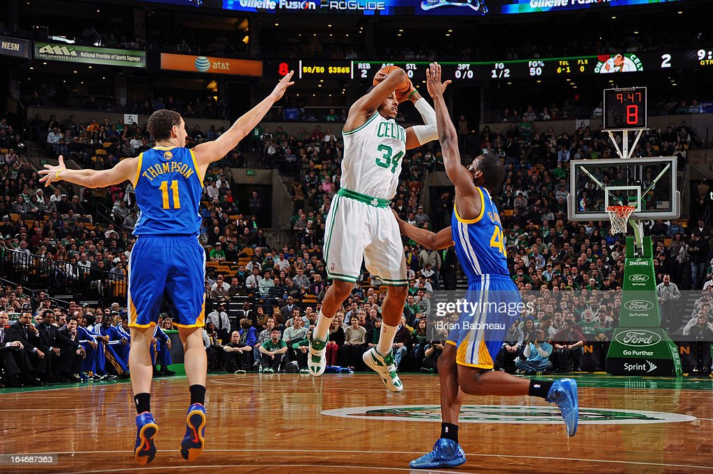 Paul Pierce #34 of the Boston Celtics passes the ball against the Golden State Warriors on March 1, 2013 at the TD Garden in Boston, Massachusetts.