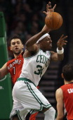 Paul Pierce of the Boston Celtics passes the ball as Andrea Bargnani of the Toronto Raptors defends on January 7 2011 at the TD Garden in Boston...