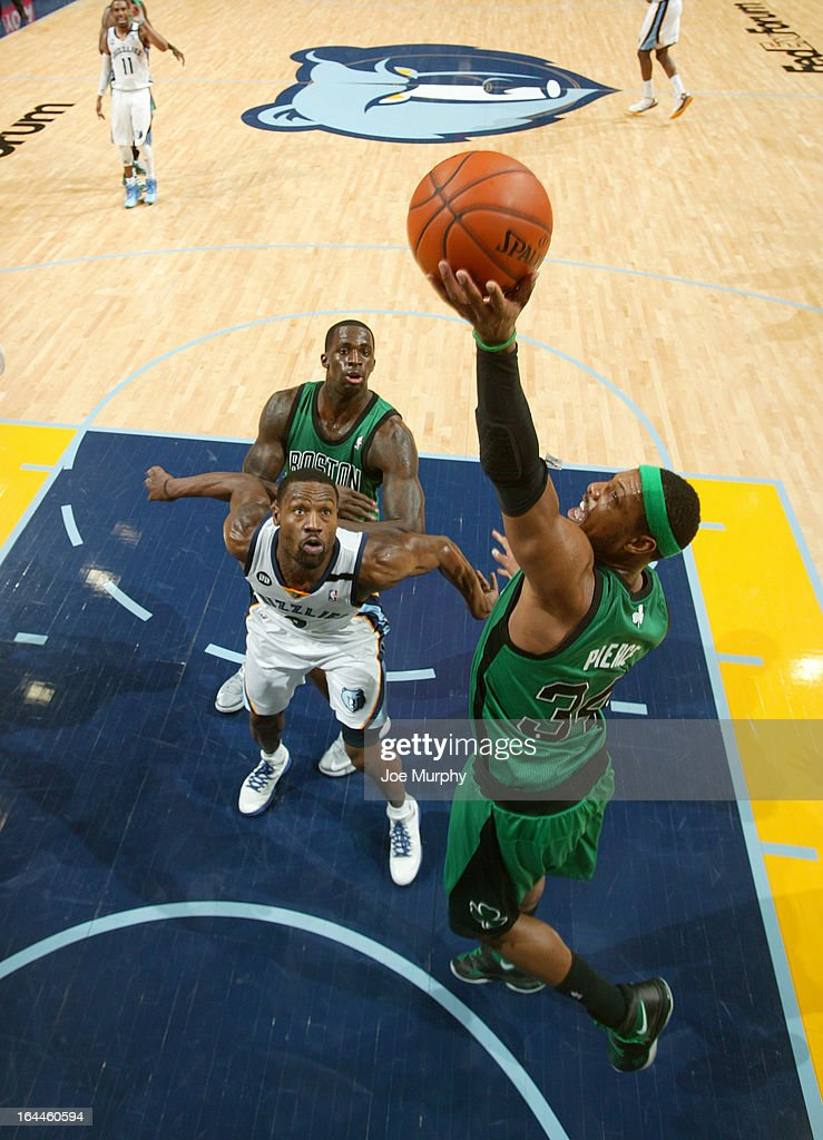 Paul Pierce #34 of the Boston Celtics rebounds against Tony Allen #9 of the Memphis Grizzlies on March 23, 2013 at FedExForum in Memphis, Tennessee.