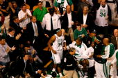 Paul Pierce of the Boston Celtics returns to the court after being taken off in a wheelchair in the third quarter of Game One of the 2008 NBA Finals...