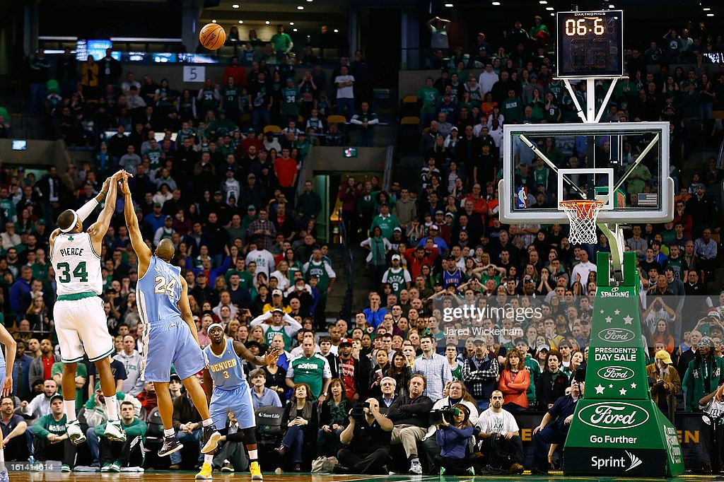 Paul Pierce #34 of the Boston Celtics shoots a three-point shot to tie the game and take it into a third overtime over Andre Miller #24 of the Denver Nuggets during the game on February 10, 2013 at TD Garden in Boston, Massachusetts.