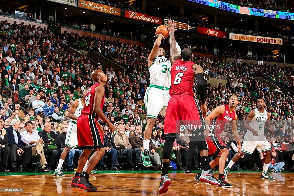 Paul Pierce #34 of the Boston Celtics shoots a three-pointer against LeBron James #6 of the Miami Heat on March 18, 2013 at TD Garden in Boston, Massachusetts.
