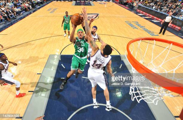 Paul Pierce of the Boston Celtics shoots against Gerald Green of the New Jersey Nets on April 14 2012 at the Prudential Center in Newark New Jersey...