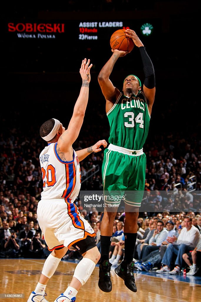 Paul Pierce #34 of the Boston Celtics shoots against Mike Bibby #20 of the New York Knicks on April 17, 2012 at Madison Square Garden in New York City.