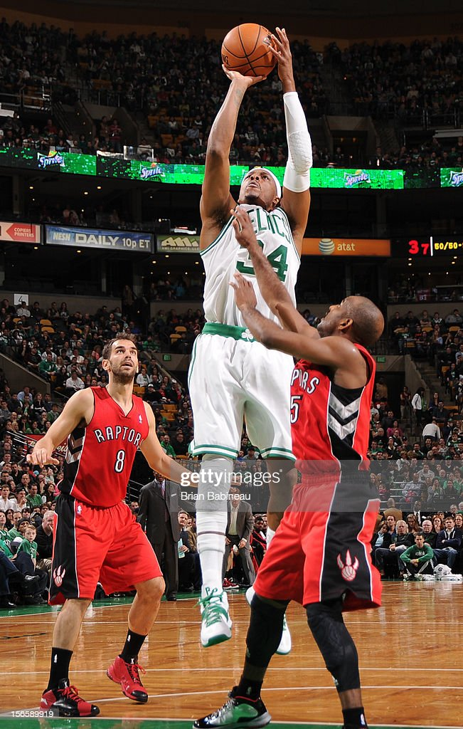 Paul Pierce #34 of the Boston Celtics shoots the ball over John Lucas #5 of the Toronto Raptors on November 17, 2012 at the TD Garden in Boston, Massachusetts.