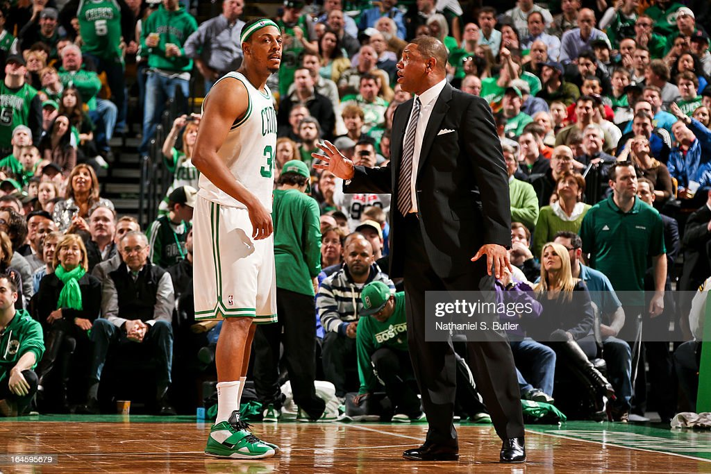 Paul Pierce #34 of the Boston Celtics speaks with Head Coach Doc Rivers during a game against the Miami Heat on March 18, 2013 at TD Garden in Boston, Massachusetts.