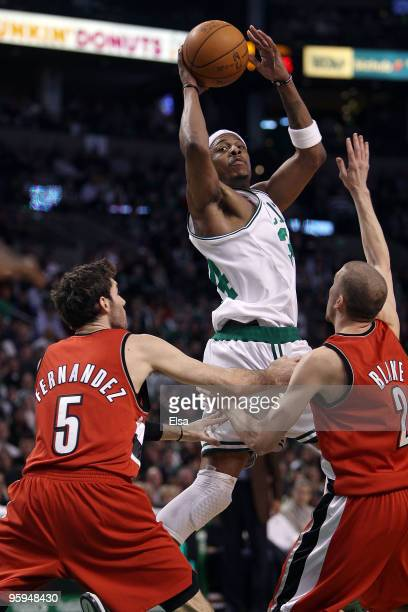 Paul Pierce of the Boston Celtics takes a shot as Rudy Fernandez and Steve Blake of the Portland Trailblazers defend at the TD Garden on January 22...