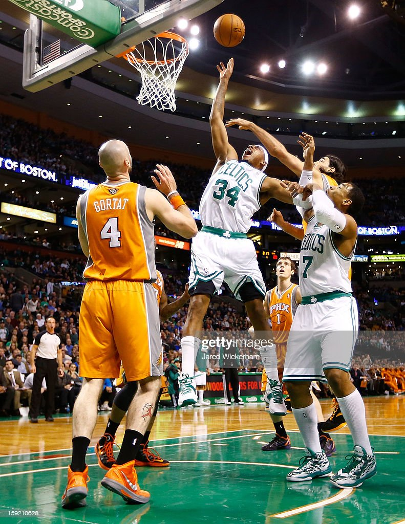 Paul Pierce #34 of the Boston Celtics tips in a shot in front of Marcin Gortat #4 of the Phoenix Suns during the game on January 9, 2013 at TD Garden in Boston, Massachusetts.