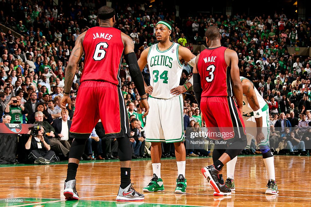 Paul Pierce #34 of the Boston Celtics waits to resume game action against LeBron James #6 and Dwyane Wade #3 of the Miami Heat on March 18, 2013 at TD Garden in Boston, Massachusetts.