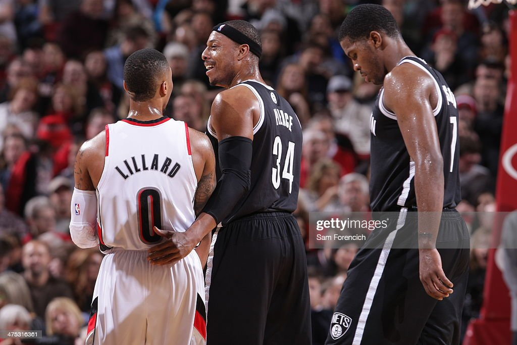 <a gi-track='captionPersonalityLinkClicked' href=/galleries/search?phrase=Paul+Pierce&family=editorial&specificpeople=201562 ng-click='$event.stopPropagation()'>Paul Pierce</a> #34 of the Brooklyn Nets and <a gi-track='captionPersonalityLinkClicked' href=/galleries/search?phrase=Damian+Lillard&family=editorial&specificpeople=6598327 ng-click='$event.stopPropagation()'>Damian Lillard</a> #0 of the Portland Trail Blazers talk during the game on February 26, 2014 at the Moda Center Arena in Portland, Oregon.