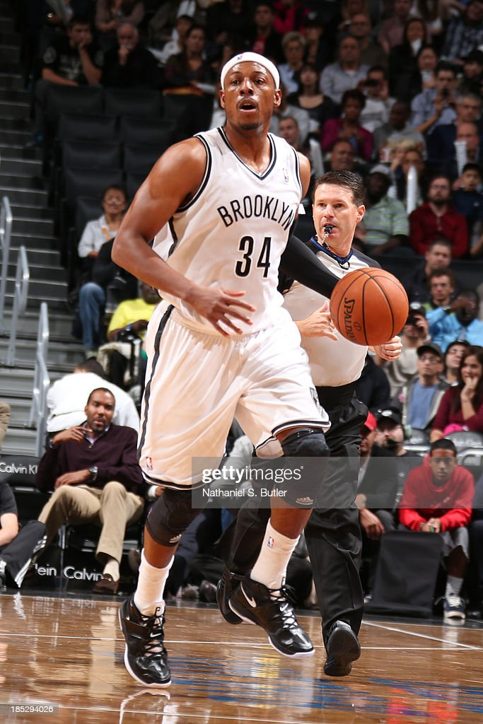 <a gi-track='captionPersonalityLinkClicked' href=/galleries/search?phrase=Paul+Pierce&family=editorial&specificpeople=201562 ng-click='$event.stopPropagation()'>Paul Pierce</a> #34 of the Brooklyn Nets brings the ball up court against the Boston Celtics during a preseason game at the Barclays Center on October 15, 2013 in the Brooklyn borough of New York City.