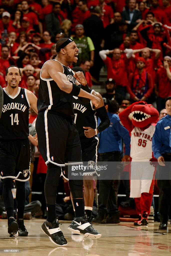 <a gi-track='captionPersonalityLinkClicked' href=/galleries/search?phrase=Paul+Pierce&family=editorial&specificpeople=201562 ng-click='$event.stopPropagation()'>Paul Pierce</a> #34 of the Brooklyn Nets celebrates after winning against the Toronto Raptors in Game Seven of the Eastern Conference Quarterfinals during the NBA Playoffs at the Air Canada Centre on May 4, 2014 in Toronto, Ontario, Canada.
