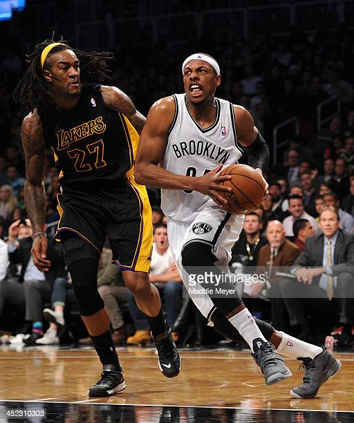 Paul Pierce of the Brooklyn Nets drives past Jordan Hill of the Los Angeles Lakers during the second half at Barclays Center on November 27 2013 in...