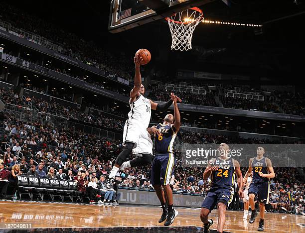 Paul Pierce of the Brooklyn Nets goes up to shoot against Jamaal Tinsley of the Utah Jazz during a game at Barclays Center on November 5 2013 in the...
