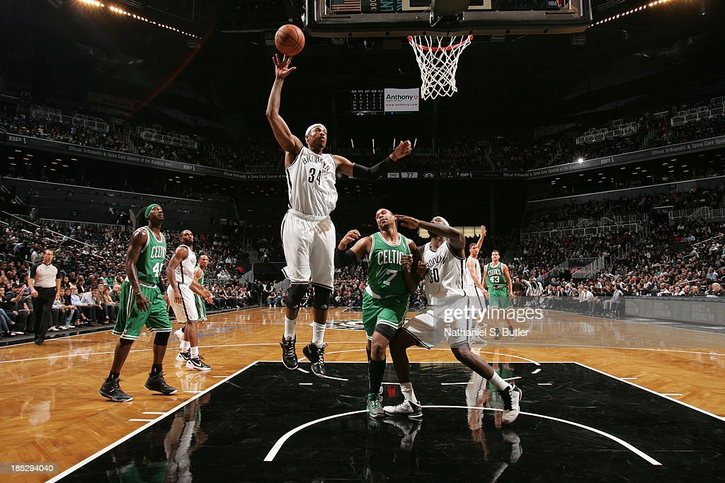 <a gi-track='captionPersonalityLinkClicked' href=/galleries/search?phrase=Paul+Pierce&family=editorial&specificpeople=201562 ng-click='$event.stopPropagation()'>Paul Pierce</a> #34 of the Brooklyn Nets grabs a rebound against the Boston Celtics during a preseason game at the Barclays Center on October 15, 2013 in the Brooklyn borough of New York City.