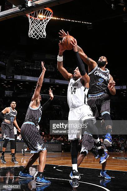 Paul Pierce of the Brooklyn Nets is blocked by Kyle O'Quinn of the Orlando Magic during a game at the Barclays Center on January 21 2014 in the...