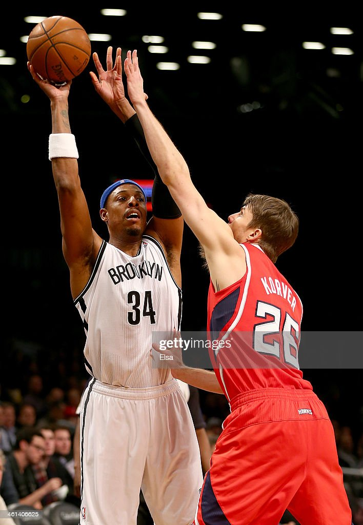 <a gi-track='captionPersonalityLinkClicked' href=/galleries/search?phrase=Paul+Pierce&family=editorial&specificpeople=201562 ng-click='$event.stopPropagation()'>Paul Pierce</a> #34 of the Brooklyn Nets looks to pass as <a gi-track='captionPersonalityLinkClicked' href=/galleries/search?phrase=Kyle+Korver&family=editorial&specificpeople=202504 ng-click='$event.stopPropagation()'>Kyle Korver</a> #26 of the Atlanta Hawks defends at the Barclays Center on January 6, 2014 in the Brooklyn borough of New York City.The Brooklyn Nets defeated the Atlanta Hawks 91-86.