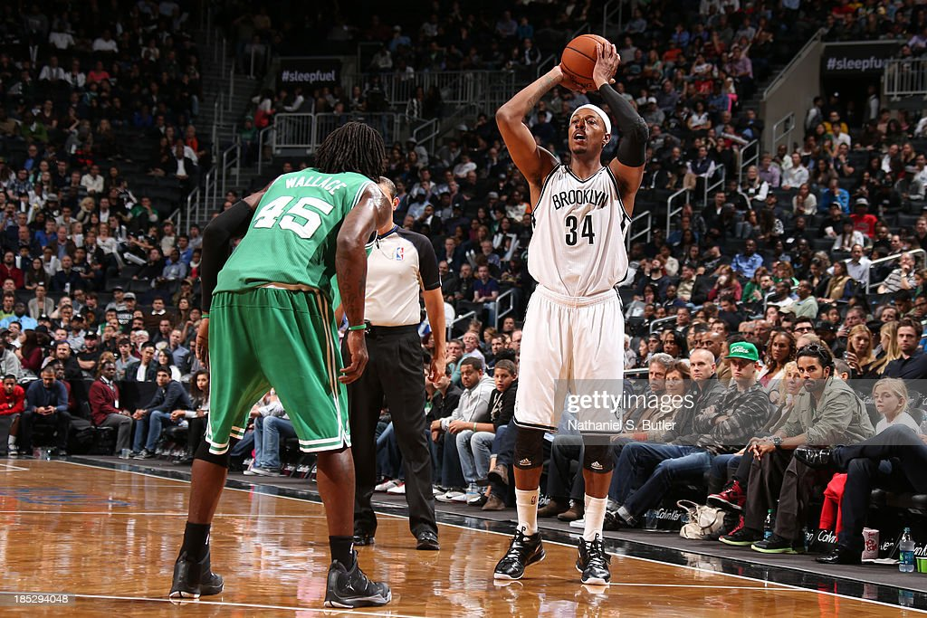 <a gi-track='captionPersonalityLinkClicked' href=/galleries/search?phrase=Paul+Pierce&family=editorial&specificpeople=201562 ng-click='$event.stopPropagation()'>Paul Pierce</a> #34 of the Brooklyn Nets passes the ball against the Boston Celtics during a preseason game at the Barclays Center on October 15, 2013 in the Brooklyn borough of New York City.
