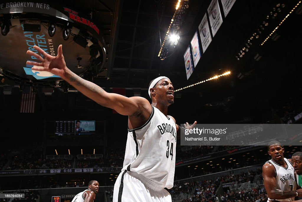 <a gi-track='captionPersonalityLinkClicked' href=/galleries/search?phrase=Paul+Pierce&family=editorial&specificpeople=201562 ng-click='$event.stopPropagation()'>Paul Pierce</a> #34 of the Brooklyn Nets plays defense against the Boston Celtics during a preseason game at the Barclays Center on October 15, 2013 in the Brooklyn borough of New York City.