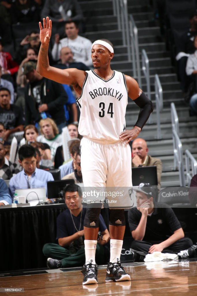 <a gi-track='captionPersonalityLinkClicked' href=/galleries/search?phrase=Paul+Pierce&family=editorial&specificpeople=201562 ng-click='$event.stopPropagation()'>Paul Pierce</a> #34 of the Brooklyn Nets stands on the court against the Boston Celtics during a preseason game at the Barclays Center on October 15, 2013 in the Brooklyn borough of New York City.