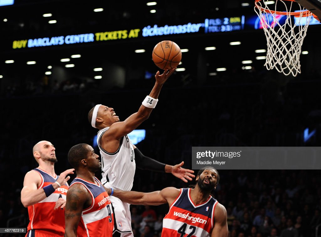 <a gi-track='captionPersonalityLinkClicked' href=/galleries/search?phrase=Paul+Pierce&family=editorial&specificpeople=201562 ng-click='$event.stopPropagation()'>Paul Pierce</a> #34 of the Brooklyn Nets takes a shot over Nene #42 of the Washington Wizards during the second half at Barclays Center on December 18, 2013 in the Brooklyn borough of New York City. The Wizards defeat the Nets 113-107.