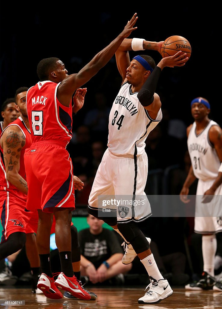Paul Pierce #34 of the Brooklyn Nets tries to pass the ball around Shelvin Mack #8 of the Atlanta Hawks at the Barclays Center on January 6, 2014 in the Brooklyn borough of New York City.