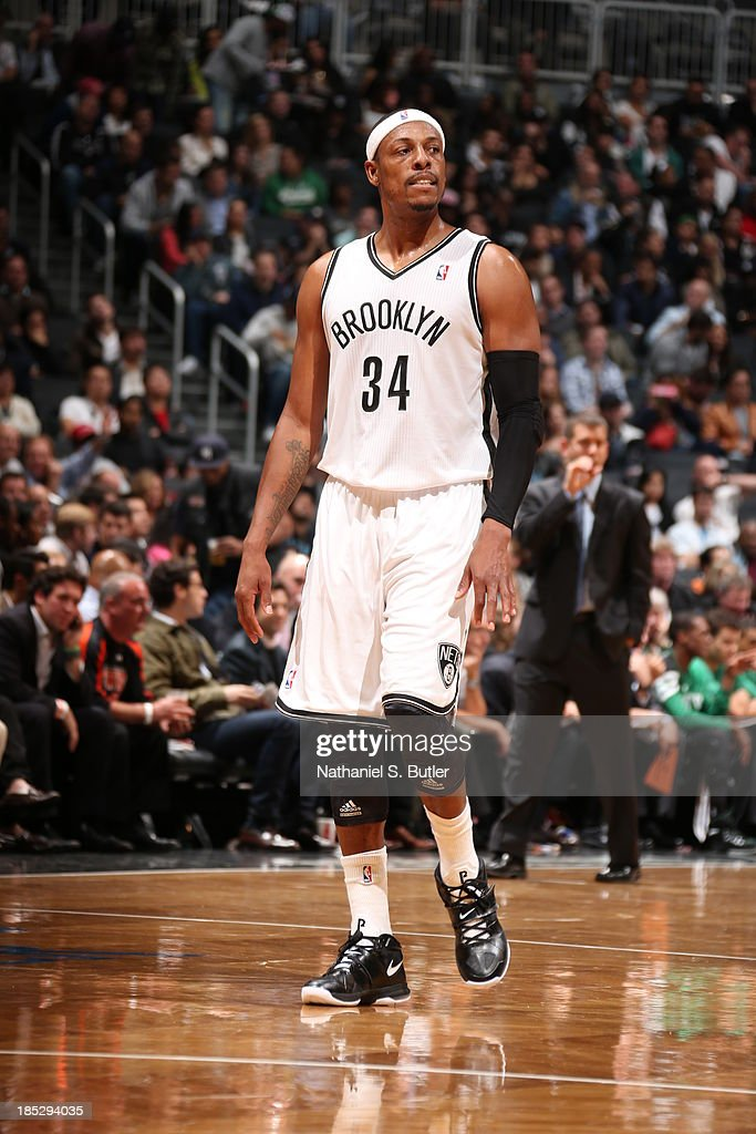 <a gi-track='captionPersonalityLinkClicked' href=/galleries/search?phrase=Paul+Pierce&family=editorial&specificpeople=201562 ng-click='$event.stopPropagation()'>Paul Pierce</a> #34 of the Brooklyn Nets walks up court against the Boston Celtics during a preseason game at the Barclays Center on October 15, 2013 in the Brooklyn borough of New York City.
