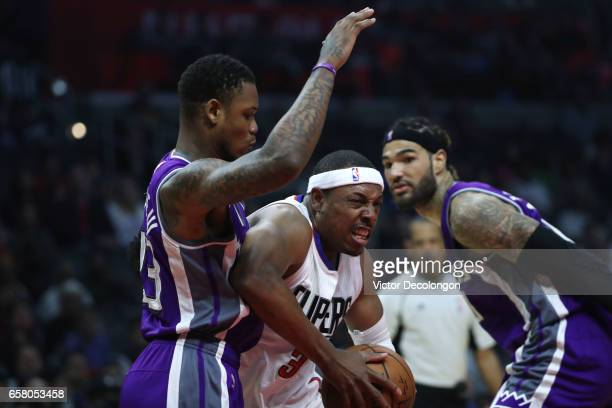 Paul Pierce of the Los Angeles Clippers drives to the basket against Ben McLemore of the Sacramento Kings as Willie CauleyStein of the Sacramento...