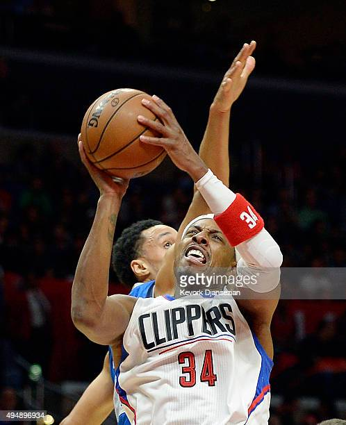 Paul Pierce of the Los Angeles Clippers shoots as he is defended by John Jenkins of the Dallas Mavericks during the third quarter of the basketball...