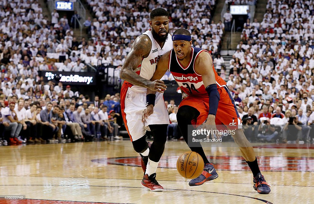 <a gi-track='captionPersonalityLinkClicked' href=/galleries/search?phrase=Paul+Pierce&family=editorial&specificpeople=201562 ng-click='$event.stopPropagation()'>Paul Pierce</a> #34 of the Washington Wizards drives to the basket past <a gi-track='captionPersonalityLinkClicked' href=/galleries/search?phrase=Amir+Johnson&family=editorial&specificpeople=556786 ng-click='$event.stopPropagation()'>Amir Johnson</a> #15 of the Toronto Raptors during game one of their NBA Eastern Conference quarterfinal playoffs at the Air Canada Centre on April 18, 2015 in Toronto, Ontario, Canada.