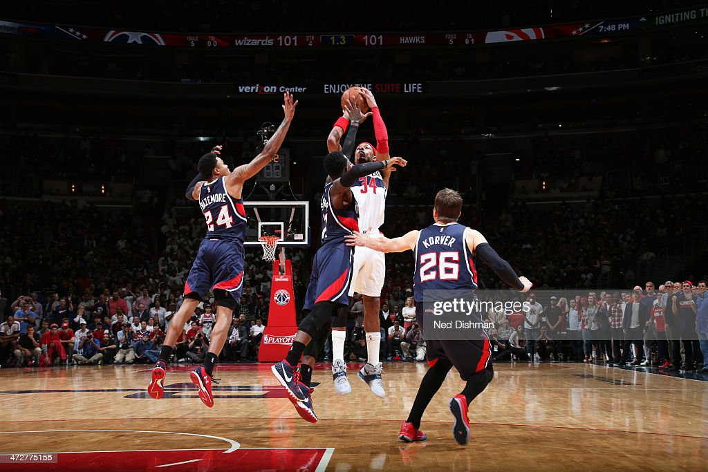 <a gi-track='captionPersonalityLinkClicked' href=/galleries/search?phrase=Paul+Pierce&family=editorial&specificpeople=201562 ng-click='$event.stopPropagation()'>Paul Pierce</a> #34 of the Washington Wizards makes the game winning shot with no time left on the clock against the Atlanta Hawks in Game Three of the Eastern Conference Semifinals of the 2015 NBA Playoffs at the Verizon Center on May 9, 2015 in Washington, DC.