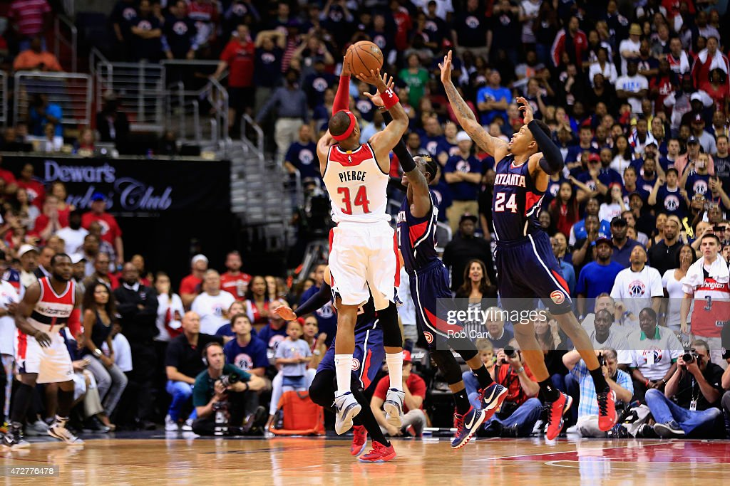 <a gi-track='captionPersonalityLinkClicked' href=/galleries/search?phrase=Paul+Pierce&family=editorial&specificpeople=201562 ng-click='$event.stopPropagation()'>Paul Pierce</a> #34 of the Washington Wizards puts up the game shot over <a gi-track='captionPersonalityLinkClicked' href=/galleries/search?phrase=Kent+Bazemore&family=editorial&specificpeople=6846101 ng-click='$event.stopPropagation()'>Kent Bazemore</a> #24 of the Atlanta Hawks to the give the Wizards a 103-101 win in Game Three of the Eastern Conference Semifinals of the 2015 NBA Playoffs at Verizon Center on May 9, 2015 in Washington, DC.