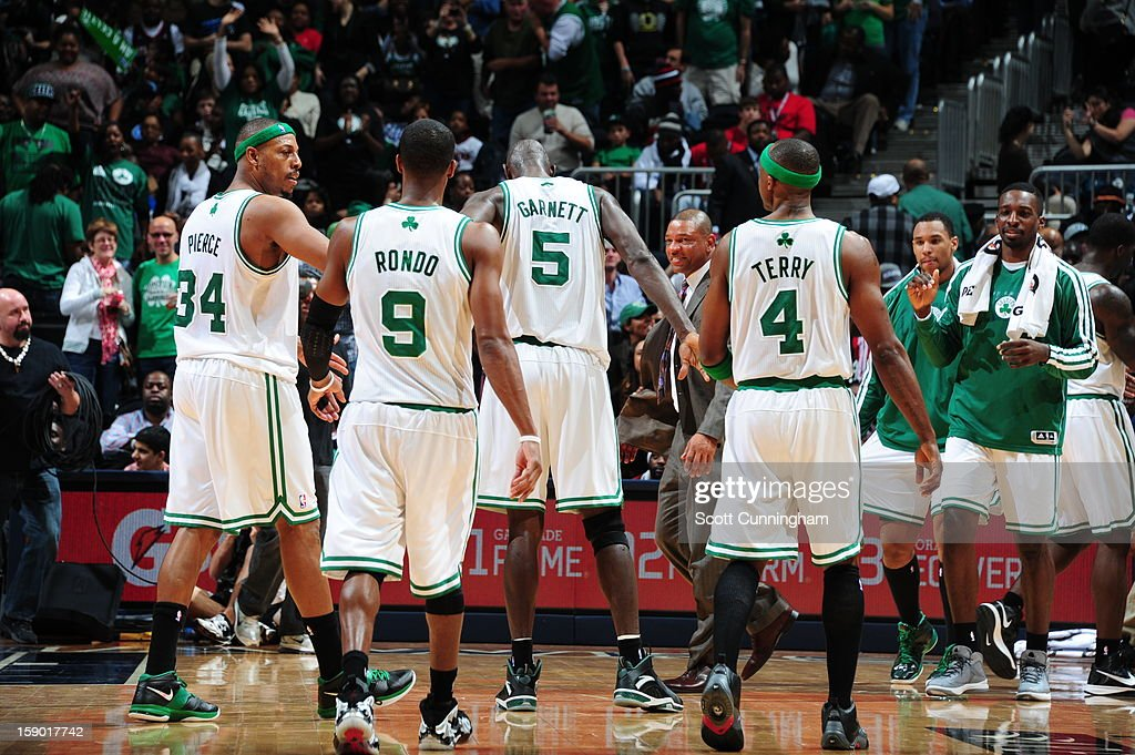 Paul Pierce #34, Rajon Rondo #9, Kevin Garnett #5, and Jason Terry #4 of the Boston Celtics walk off the court during a break in play against the Atlanta Hawks on January 5, 2013 at Philips Arena in Atlanta, Georgia.