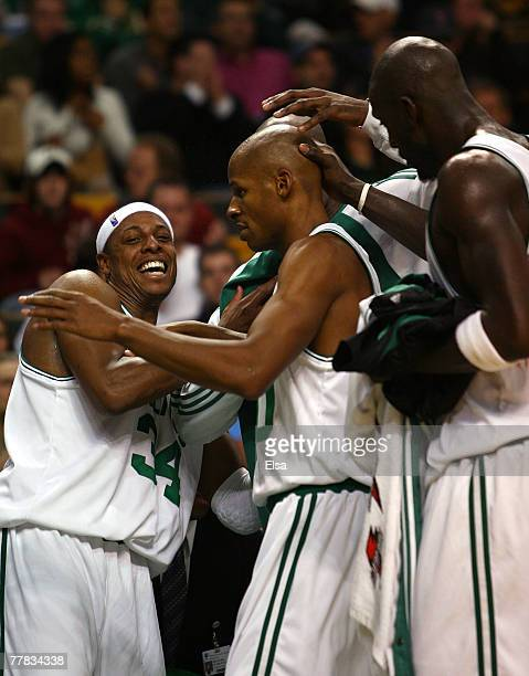 Paul Pierce Ray Allen and Kevin Garnett of the Boston Celtics are all smiles after they are pulled from the game late in the fourth quarter against...