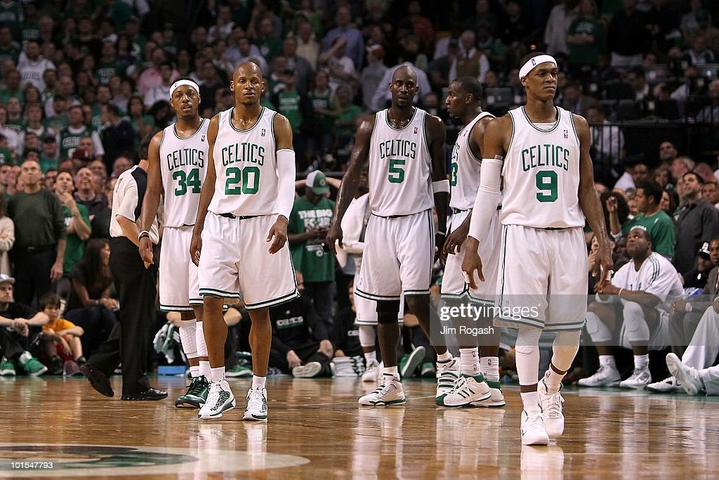Paul Pierce #34, Ray Allen #20, Kevin Garnett #5 and Rajon Rondo #9 of the Boston Celtics look on against the Orlando Magic in Game Six of the Eastern Conference Finals during the 2010 NBA Playoffs at TD Garden on May 28, 2010 in Boston, Massachusetts.