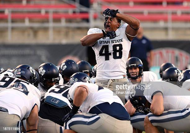 Paul Piukala of the Utah State Aggies rallies his teammates before their game against the UNLV Rebels at Sam Boyd Stadium on November 9 2013 in Las...