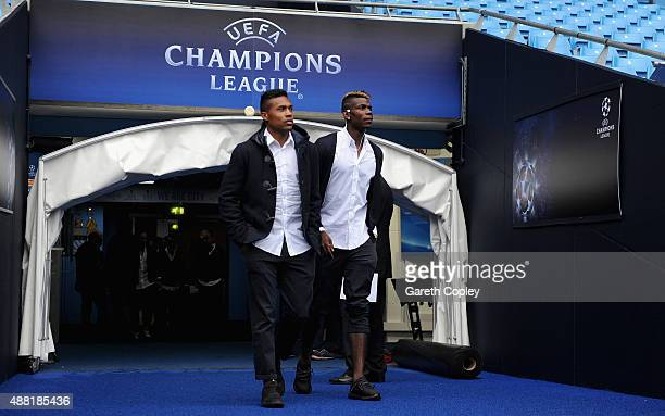 Paul Pogba and Alex Sandro of Juventus arrive for a walkaround the Etihad Stadium on September 14 2015 in Manchester United Kingdom