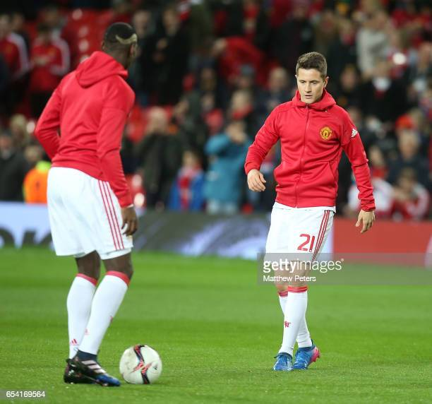 Paul Pogba and Ander Herrera of Manchester United warm up ahead of the UEFA Europa League Round of 16 second leg match between Manchester United and...