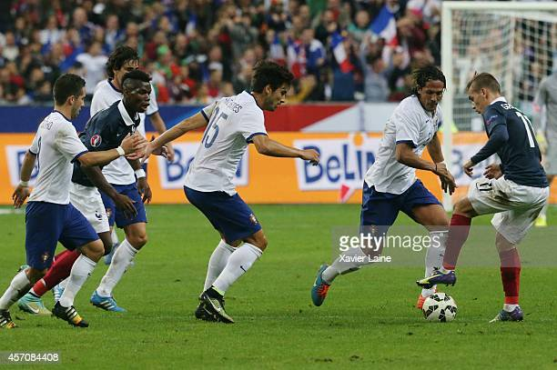 Paul Pogba and Antoine Griezmann of France and Andre Gomes and Bruno Alves of Portugalduring the International Friendly Soccer match between France...