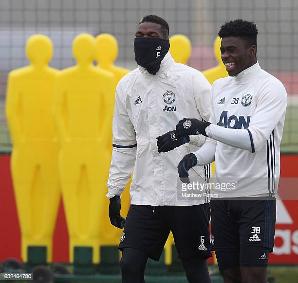 Paul Pogba and Axel Tuanzebe of Manchester United in action during a first team training session at Aon Training Complex on January 23 2017 in...
