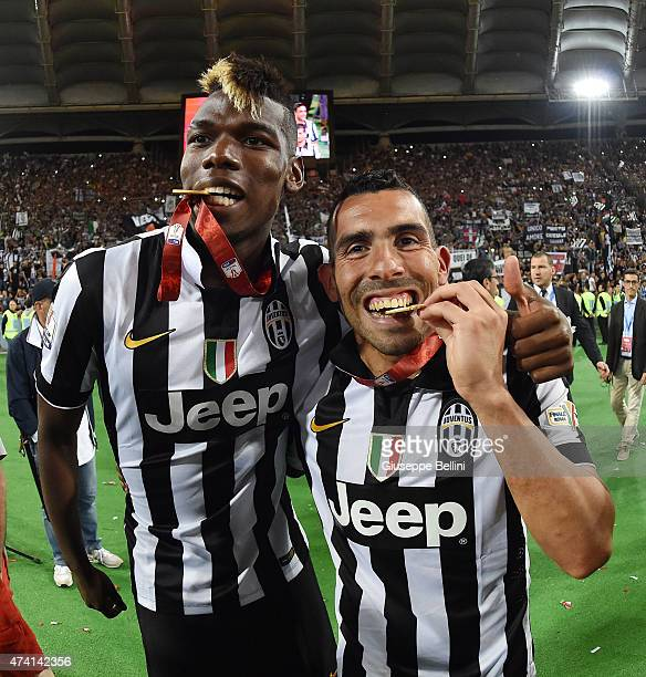 Paul Pogba and Carlos Tevez of Juventus celebrate the victory after the TIM Cup final match between SS Lazio and Juventus FC at Olimpico Stadium on...