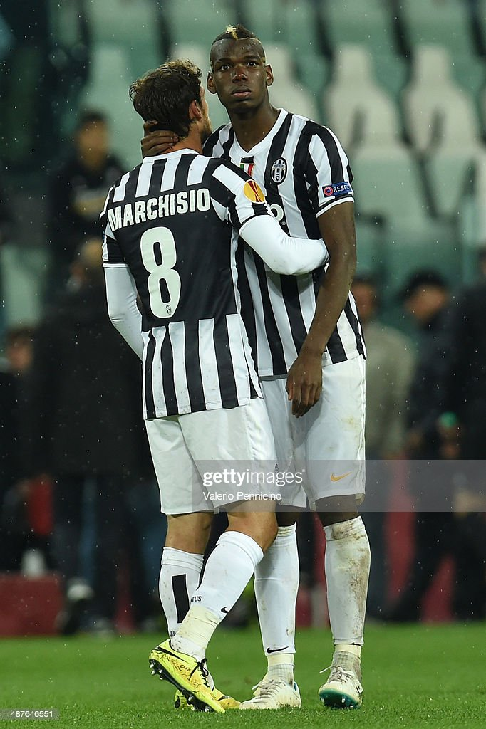 Paul Pogba (R) and Claudio Marchisio of Juventus show their dejection at the end of the UEFA Europa League semi final match between Juventus and SL Benfica at Juventus Arena on May 1, 2014 in Turin, Italy.