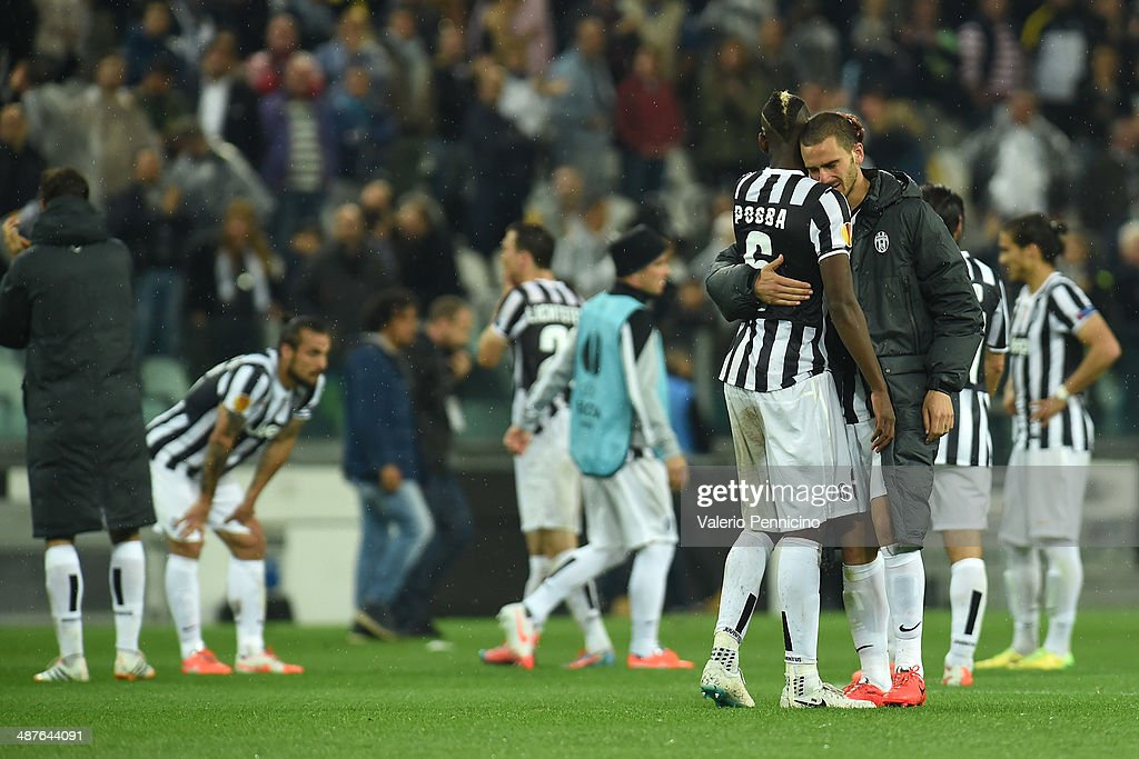 Paul Pogba (L) and Leonardo Bonucci (R) of Juventus show their dejection at the end of the UEFA Europa League semi final match between Juventus and SL Benfica at Juventus Arena on May 1, 2014 in Turin, Italy.
