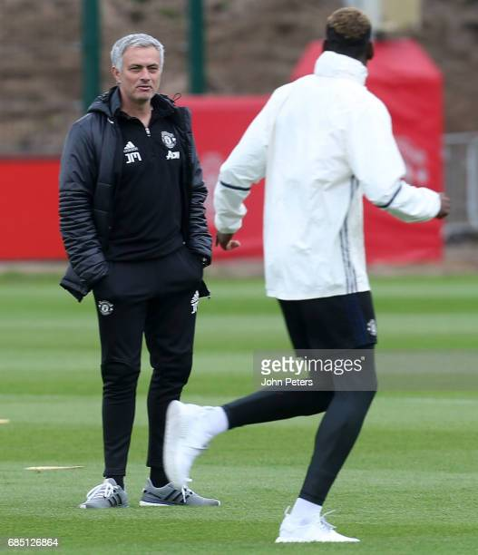 Paul Pogba and Manager Jose Mourinho of Manchester United in action during a first team training session at Aon Training Complex on May 19 2017 in...