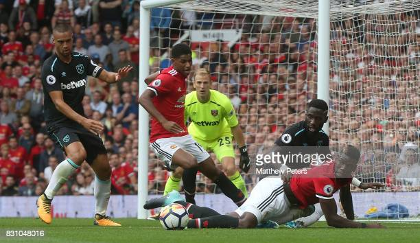 Paul Pogba and Marcus Rashford of Manchester United in action with Winston Reid and Arthur Masuaku of West Ham United during the Premier League match...