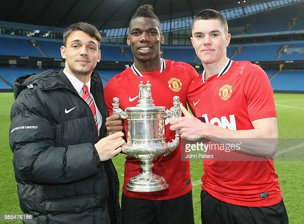 Paul Pogba and Michael Keane of Manchester United Reserves celebrate with the Manchester Senior Cup trophy after the Manchester Senior Cup Final...