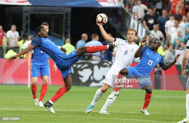 Paul Pogba and N'golo Kante of France in action with Harry Kane of England during the International Friendly match between France and England at...