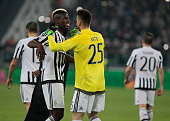 Paul Pogba and Norberto Neto at the end of the Tim Cup match between Juventus FC and FC Internazionale Milano at the Juventus Stadium of turin on...
